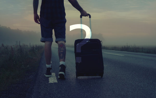 man-walking-on-the-road-holding-black-luggage-during-sunset-160483